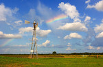 Rainbow over Texas pasture land
