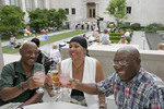 Black adults enjoying Jazz picnic in the Court Yard  at the Cincinnati Art Museum