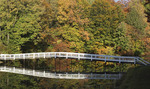 White bridge over small lake in the Fall