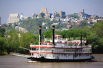 BB Riverboats take visitors on a river cruise up and down the Ohio River. Mt. Adams and the Cincinnati Skyline rise above the banks of the Ohio River. Cincinnati Ohio