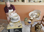 Man on pottery wheel
