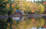 Peaceful quiet scene of lake and small boat in Long Lake in Bridgton Maine in New England