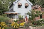 Man watering garden in backyard of his home in Ohio City neighborhood of Cleveland