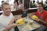 Two guys enjoying chili at Skyline Chili Restaurant in Cincinnati, Ohio