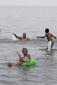 Family plays in the water of Lake Erie at Edgewater State park in Cleveland