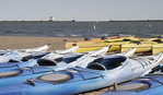 Kayaks lined up on beach at Firport Harbor beach in Lake County