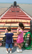 Two young kids enjoy the view from  William G. Mather Museum