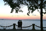 Couple enjoy sunset on Lake Erie at Voinovich poark in Cleveland
