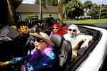 Colorful picture of retired elderly women in convertible having fun