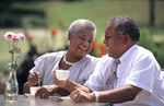 Black african american older  couple outdoors relaxing at table