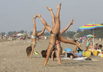 Girls doing cartwheels on the beach at Mentor Headlands State Park east of Cleveland, Ohio