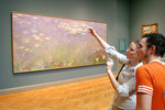 Visitors admiring impressionistic painting at Cleveland Museum of Art