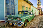 Old worn 1958 Classic Chevy on cobblestone street in center square of Trinidad Cuba an old colonial town