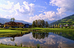 Beautiful golf with golfers at  the #18 hole at exclusive Golf Club Murau Kreischberg with alpine alps behind course