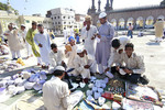 Jama masjid  mosque in Hyderabad, India buying kufis the muslim ca