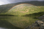 Rainbow forms over Buttle Lake in Strathcona Provincial park, Vancouver Island, Canada