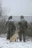 Two winter hunters with dog at Surry Dam, Surry NH