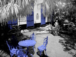 Infra red  image with blue chairs in Guanabacoa area of Havana Cuba of the Santeria Museum Habana