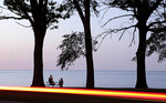 People watching sunset on Lake Erie in Cleveland, Ohio