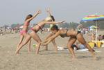 Girls doing cartwheels on beach at Mentor Headalnds State Park