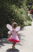 Little fairy girl walking in the garden