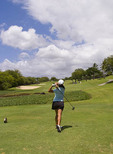 Chinese woman golfing at exclusive beautiful Wailea Emerald Course in Maui Hawaii