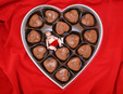 Baby in a box of chocolates.