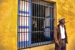 Colorful Man with Cigar Yellow Walls Old Havana Scene Cuba