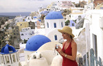 Athens Greece Woman Tourist along White Buildings of Oia in Santorini Greece