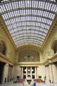 The sun shines through the ceiling and on the waiting room and interior of Union Station that opened in 1925. Presently it is the only intercity rail terminal in Chicago serving both Metra (commuter railroad) and Amtrack.