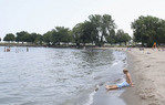 Boy on beach at Edgewater State park in Cleveland, Ohio