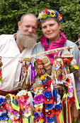 Man with beard and woman in traditional costume of Ukraine old clothes in festive in Kiev Ukraine
