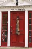 Red door decorated for Halloween