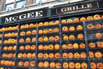 A local pub decked out with a huge collection of hand-carved pumpkins for Halloween. The tavern and girlle are located in the Lincoln Park neighborhood