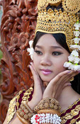 Dancer in native traditional gold ancient dance costume in Siem Reap Cambodia Asia