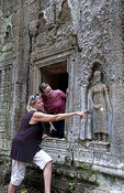 Mother and daughter tourists at  temple Ta Prohm near Anglor Wat in Siem Reap Cambodia Asia