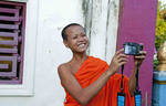 Luang Phabang Laos Lao young monk relaxing laughing with camera self portrait in garden