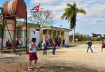 Students playing basseball outside school in Habana Province in countryside outside city in Cuba