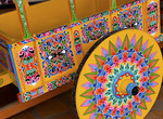 Colorful close up of famous wheel for carriages that are traditional in and around Costa Rica in Central America
