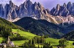 Beautiful isolated lonely church St Maddalena and village in valley  in the Italian Dolomites village of Val Di Funes