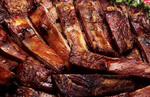 Close up of barbequed ribs with sause and beef BBQ
