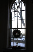 Church window with wreath in the winter