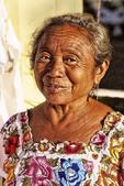 Colorful portrait of local vendor in the Chichen Itza area of Mexico