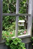 Garden window frame looking at bird feeder
