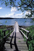 Long wooden dock leading to water