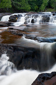 Water rushes over the many terraces of Manido Falls on the Presque Isle River in Michigan