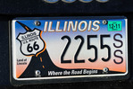 An Illinois license plaate commemorating the start of the historic U.S. Route 66 which begins only a mile or so from where the vehicle is parked. Chicago, Illinois.
