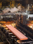 Molten steel on the twin-strand continuous slab caster - Mittal Steel USA - Cleveland Inc., a fully integrated steel-making facility