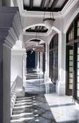 Singapore shadows in hallways of world famous Raffles Hotel 1887 exclusive resort