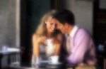 Young couple having affectionate talk in cafe